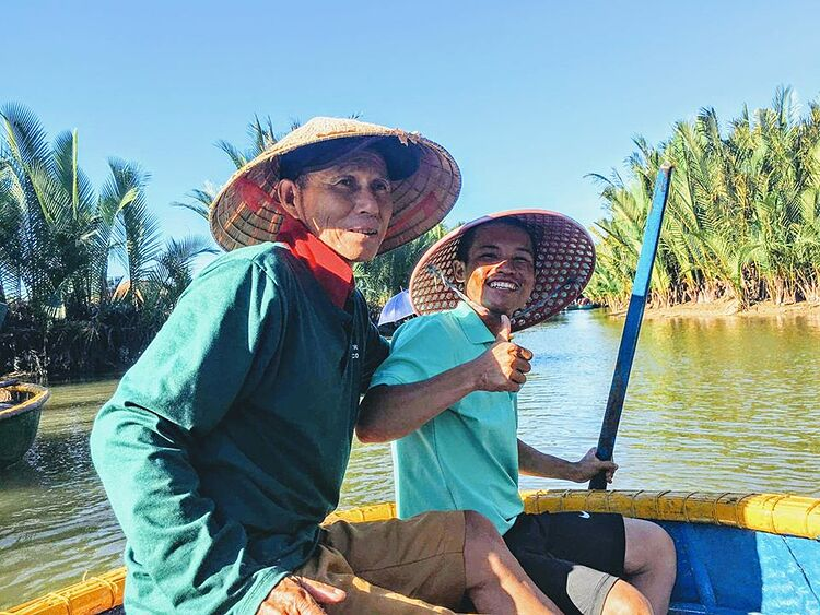 Quy poses for a photo with local fisherman near Hoi An ancient town, Quang Nam Province. Photo courtesy of Quy.
