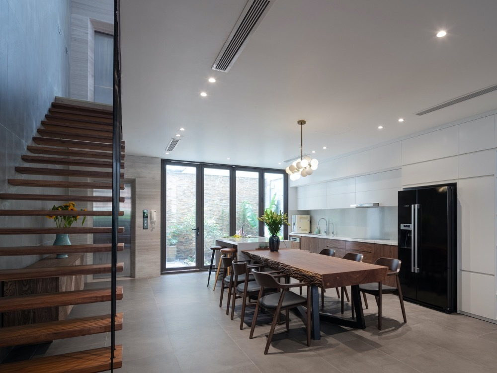 Staircase is places at the back to save more space inside. Because the tube structure is often narrow horizontally, saving space plays an important role.