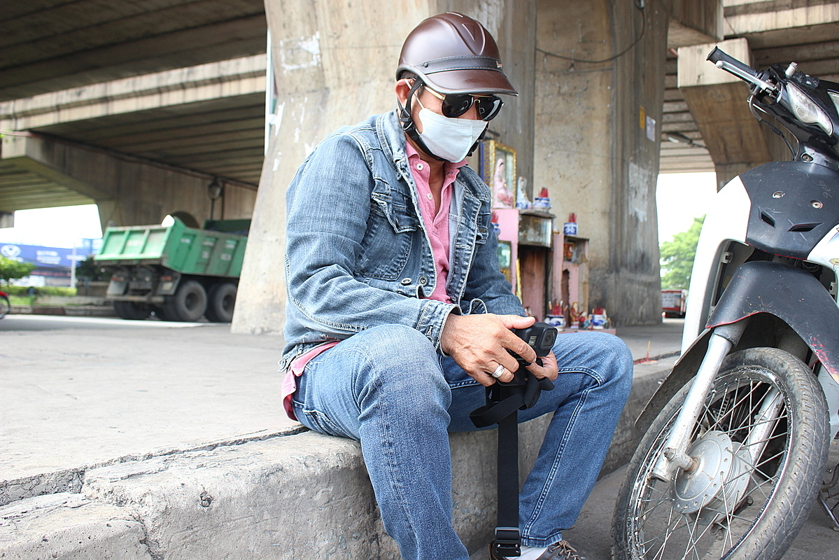 Luy travels around and patrols local areas when he is not in his shift. Photo by VnExpress/Diep Phan.