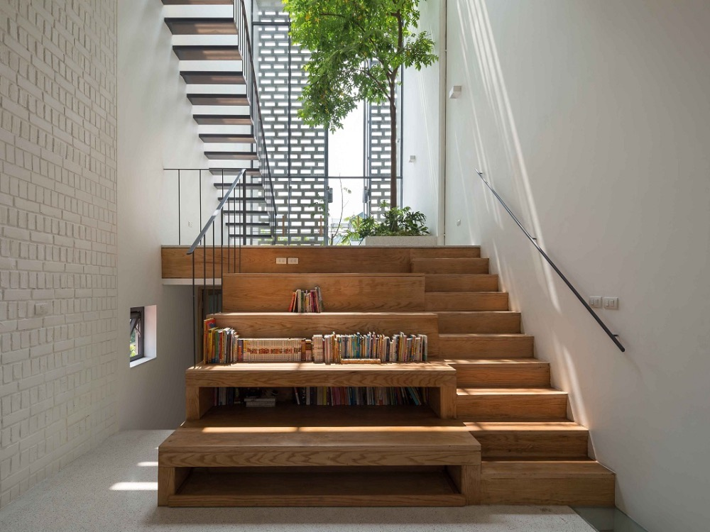Trees are planted inside while common areas like the living or dining rooms are designed at different levels to replicate the notion of space.