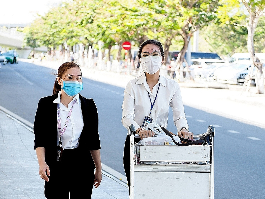 Masks become a must for people traveling and working at the airport, from the parking lot the luguage belts.