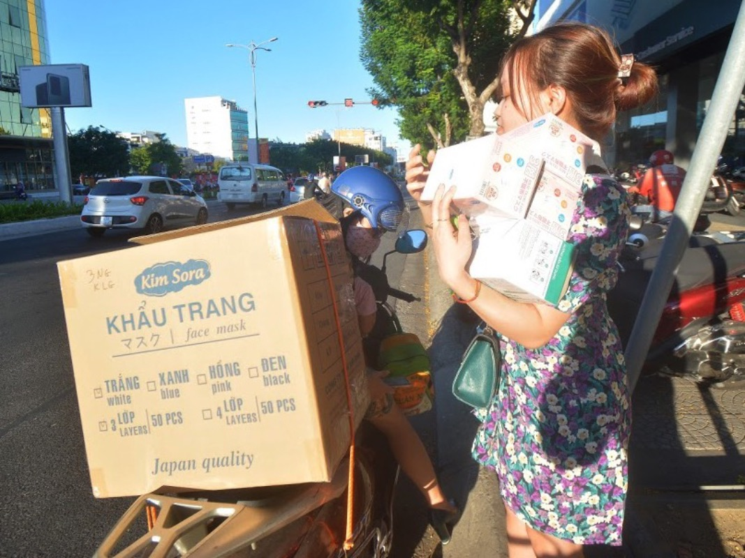 Van Thi Thao, 27, buys boxes of masks for her family, friends and colleagues.