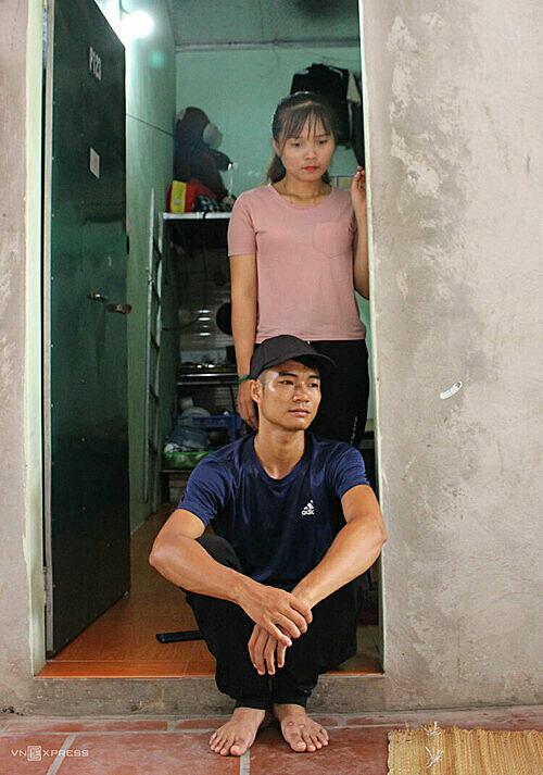 Khon and Phong in front of their rental studio. Photo by VnExpress/Hoang Phuong.