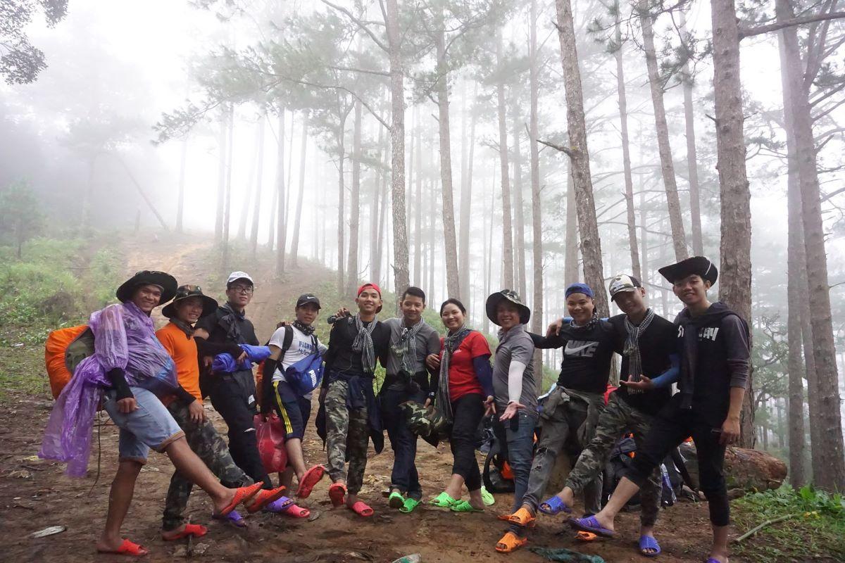 Xu Kiens trekking group in a pine forest submerged in fog, Ta Nang Commune. Photo by Xu Kien.