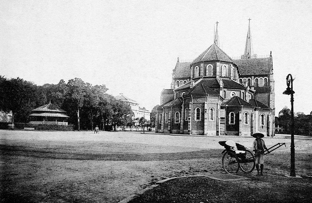 A view of the old Saigon Notre Dame Cathedral. The cathedral did not have two bell towers when it inaugurated in 1880. They were later added in 1985, using a total of six large bronze bells, with two crosses on top of the roofs to peak at 60.5 m above ground.