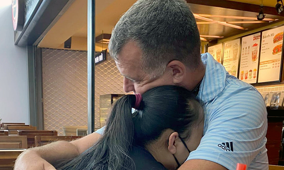 Wedel and Trang say goodbye before the husband returns to the U.S. on March 24, 2020. Photo courtesy of Trang.
