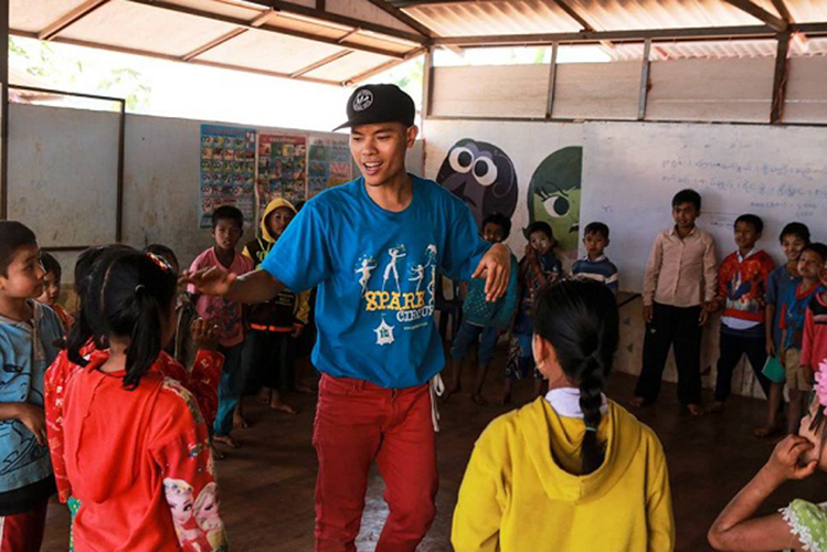 Tuan teaches dancing for children at a refugee camp in Thailand in 2018. Photo courtesy of Tuan.