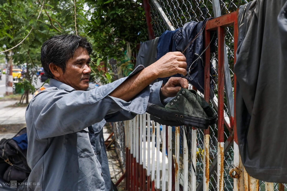 Ho hangs his shoes and clothes on a fence before resuming his work in the afternoon. Every day, we have to bring shampoo, soap and some clothes. This job required us to shower several times per day, or else out body will be itchy, Ho maintained.