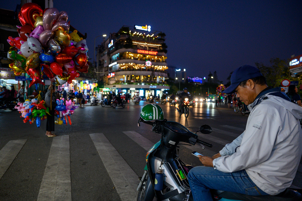 A driver waits for passengers in Hanoi. Photo by Shutterstock/Miroslaw Gierczyk.