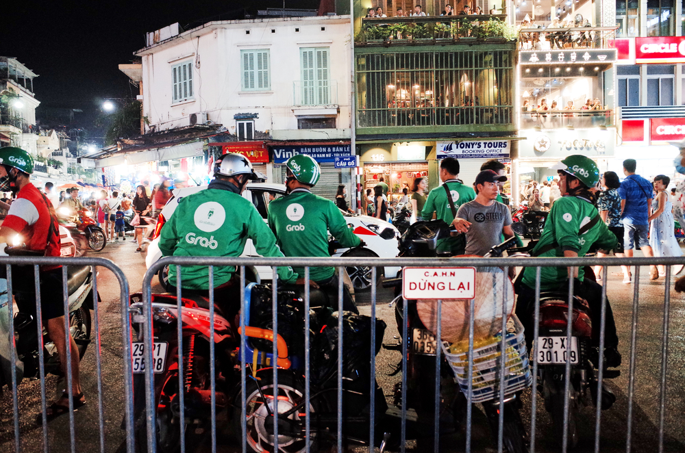 Grab drivers in Hanois Hoan Kiem District. Photo by Shutterstock/Julie Mayfeng.