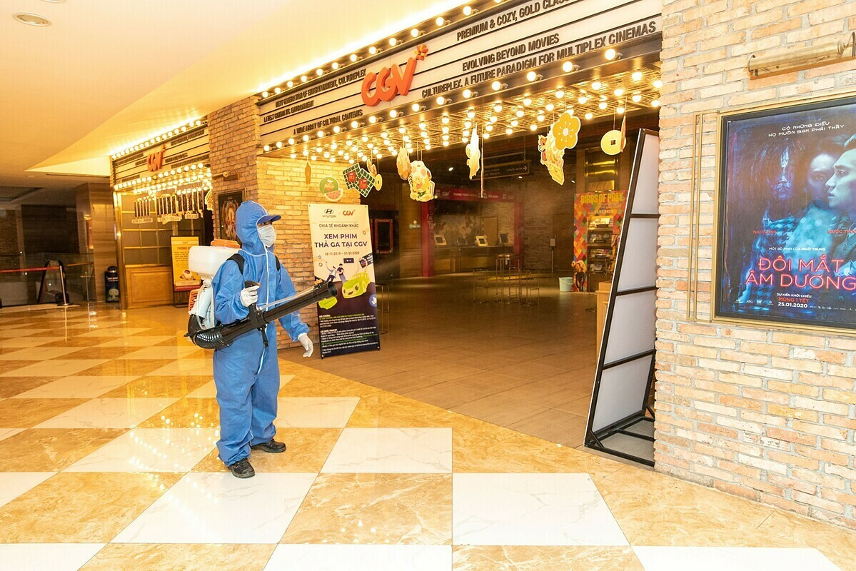 A staff member sanitizes a cinema of CGV. Photo courtesy of CGV.