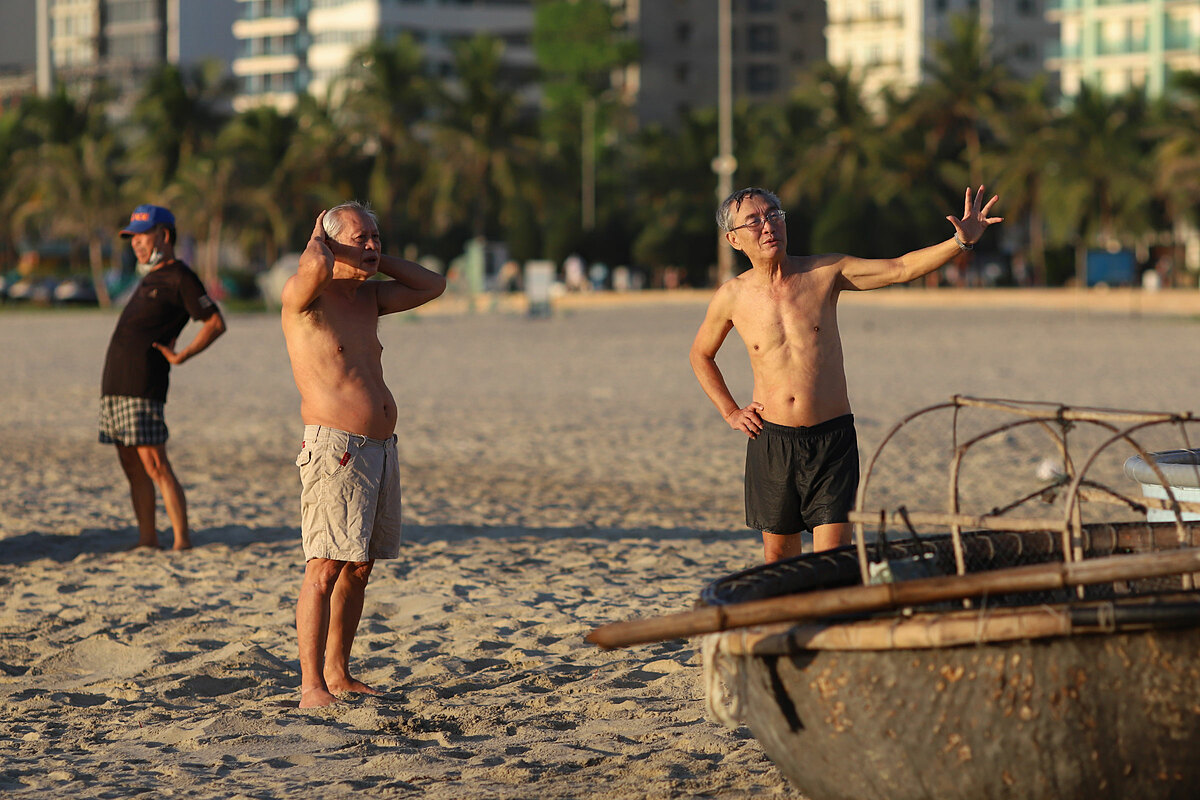 Men sunbathe on the beach. Since July 28, the city banned residents from swimming to curb the spread of domestic infections after the first community transmission was recorded on July 25 after more than three months.