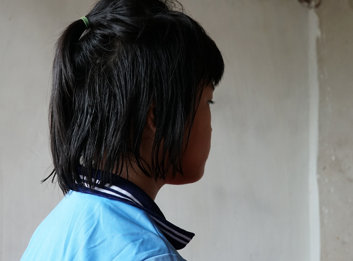 Duyen, a ten-year-old girl who has been forced by her mother and uncle to take two of her little brothers to the streets and beg for money. Photo by VnExpress/Truong Ha