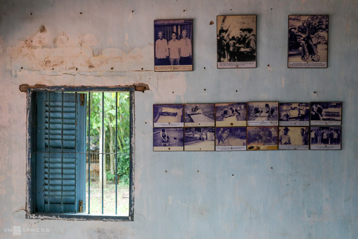 Pictures of activities during war time are hung on the wall.