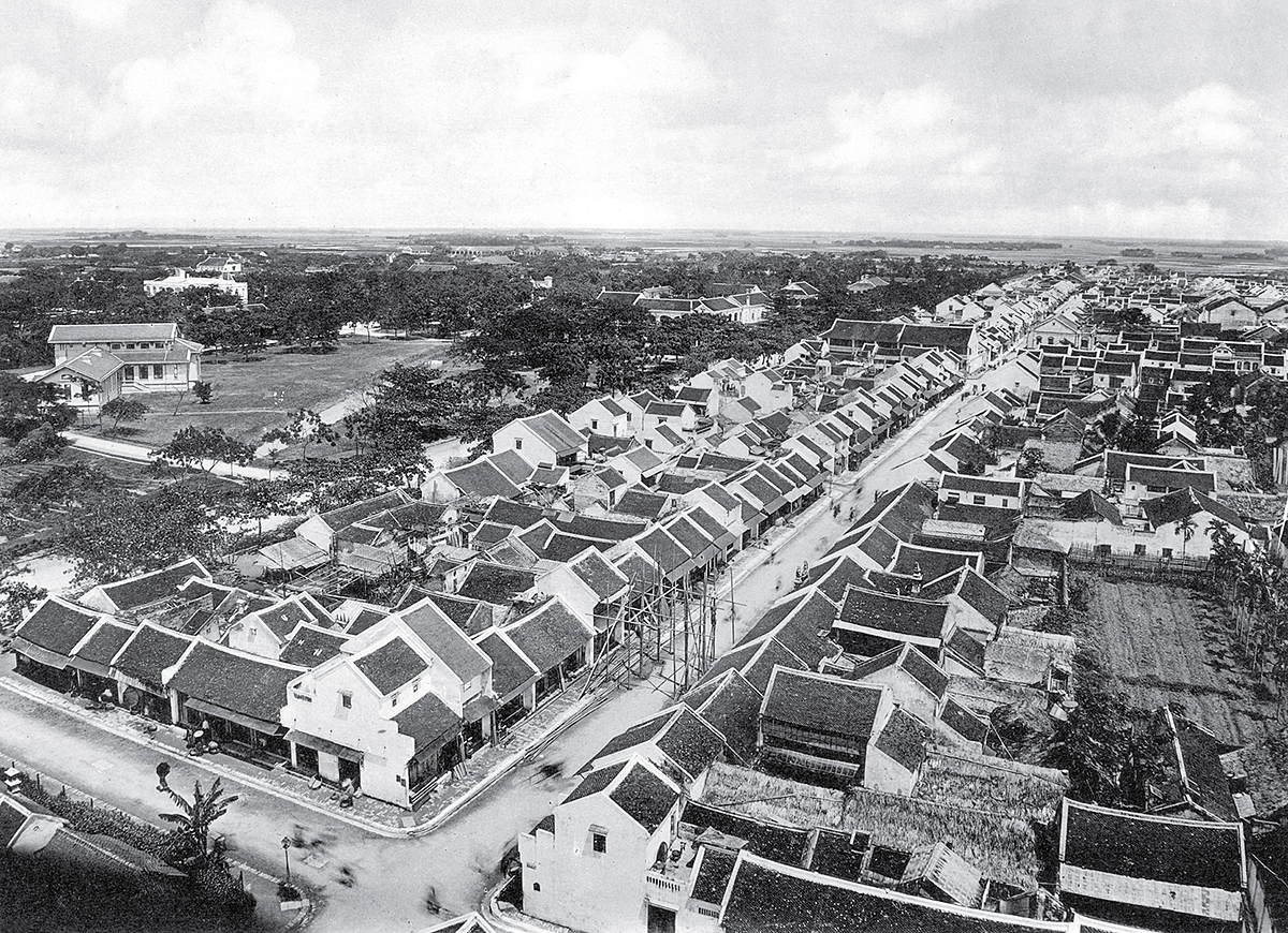 The downtown area of Nam Dinh Province is viewed from above with  tiled roof architecture and close-up houses.