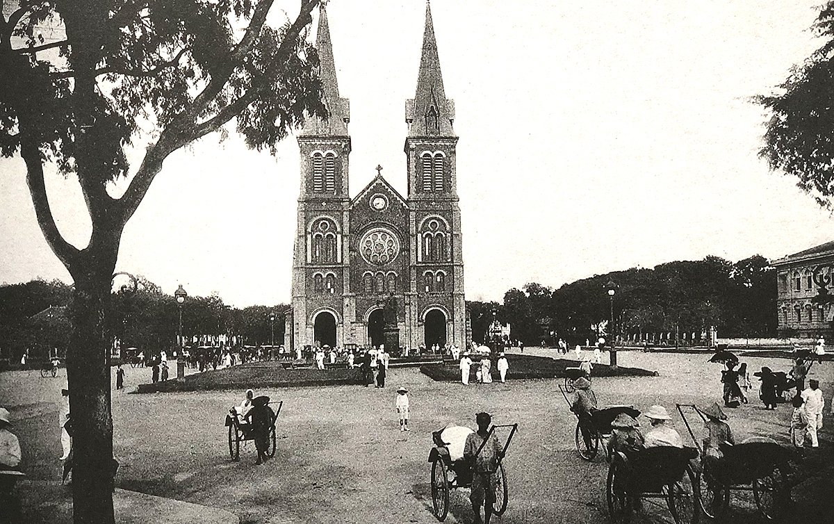 A view of the old Saigon Notre Dame Cathedral. The cathedral did not have two bell towers when inaugurated in 1880. They were later added in 1985, to include a total of six large bronze bells, with two crosses at the top, 60.5 m above ground. Located in a tourist precinct that includes the historic Central Post Office in District 1, the 140-year-old cathedral is popular among foreign and local visitors, especially during holiday seasons.