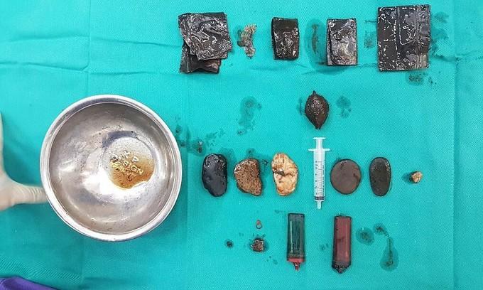 Lighter, razor blade found in Hanoi man's body