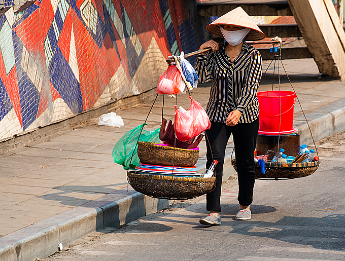 A street vendor in Hanoi. Photo by Shuttlestock/Cesare Palma.