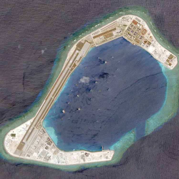 A satellite photo of China-occupied Subi Reef at Vietnams Truong Sa (Spratly) Islands, March 20, 2018.  Photo by Planet Labs/Handout via Reuters.