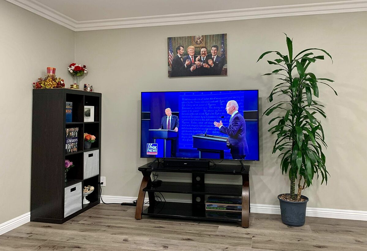 A TV in Julia Ngos home in California, the U.S. shows the first 2020 U.S. Presidential debate between President Donald Trump and Democratic presidential nominee Joe Biden on September 29, 2020. Photo by Julia Ngo.