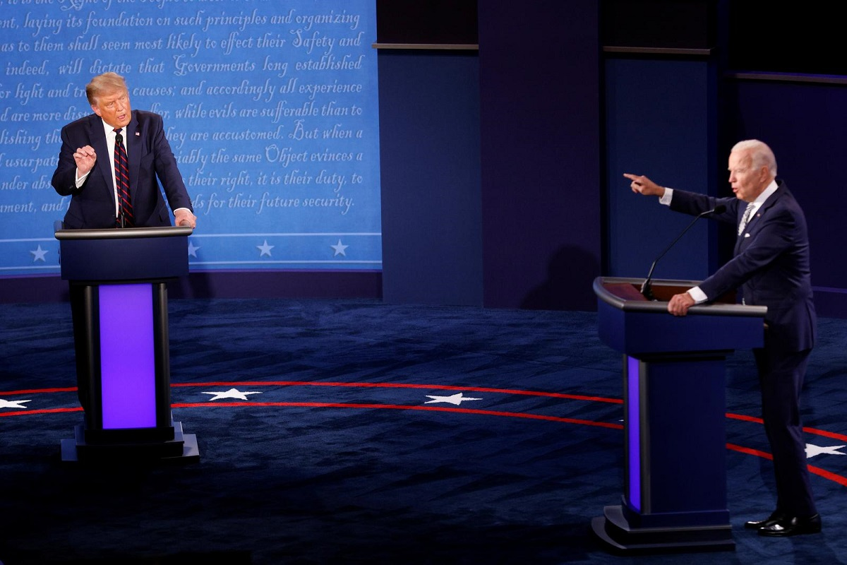 President Donald Trump and Democratic presidential nominee Joe Biden in the middle of the debate. Photo by Reuters/Brian Snyder.