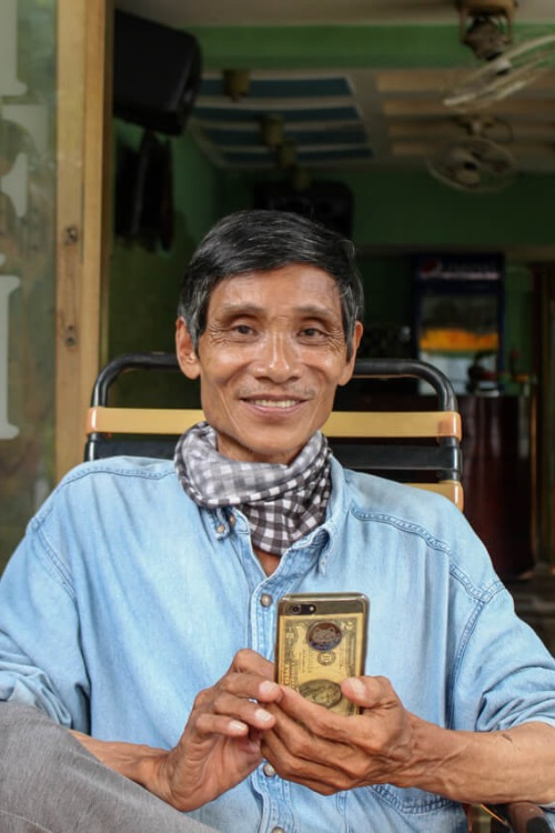 I used to be a mechanic and a carpenter when I was young. About a decade ago, my health got worse and I decided to become a lottery seller, but I did not earn well. So I became a delivery man, using my own tricycle, said Nguyen Duy Long, 65, residing on Hiep Binh Chanh Commune, Saigons Thu Duc District. He has been living with his paralyzed legs since he was one year old.