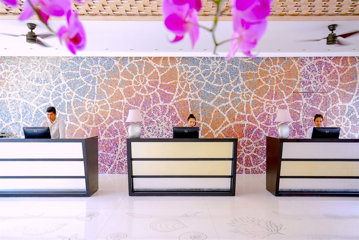 The elegance of this purple backsplash aligned with the translucent white floors of the main lobby affording a truly splendid accent to the space.
