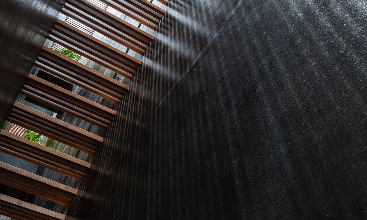 Voids between wooden bars allow natural light to enter and create impressive visual effects. Photo by Quang Dam.