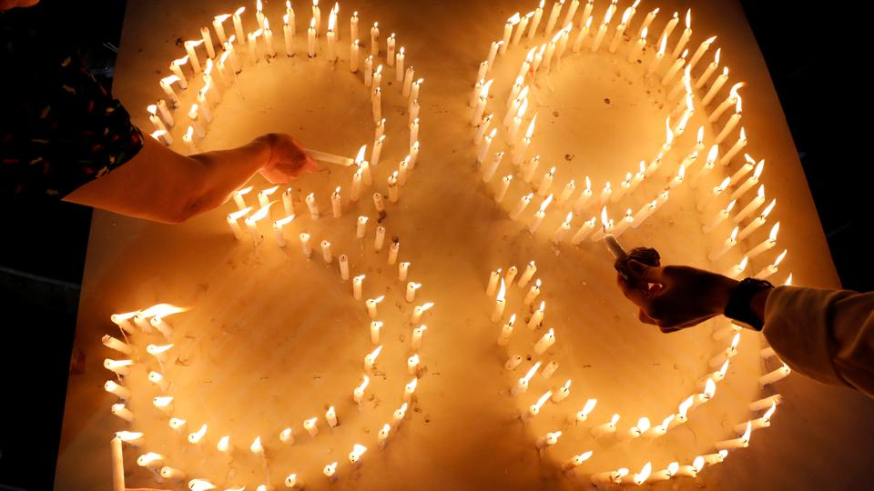 People light candles during a mass prayer for 39 Vietnamese people found dead in a truck near London, at a church in Nghe An Province, central Vietnam, November 30, 2019.