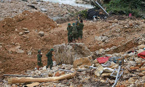Digging deep: Rescuers work non-stop in search for landslide victims