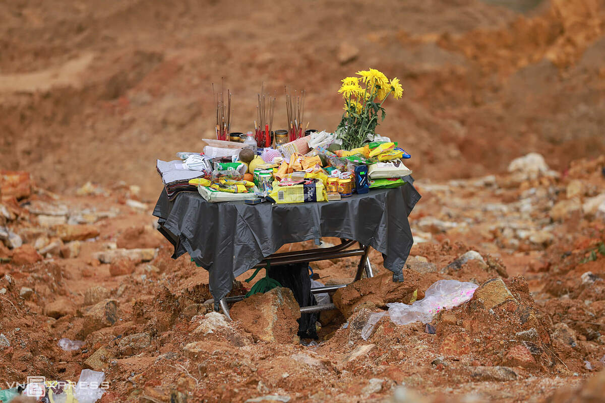 A small altar filled with flower, fruits and cakes is placed in the middle of Rao Trang 3 area where 13 workers were still listed missing 12 days after the incident.