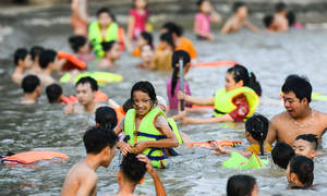 Vietnam makes major push for children to learn swimming