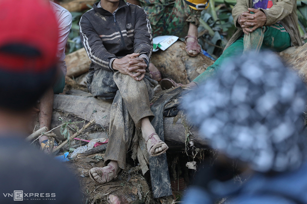 A local man wears a pair of sandal gifted by a soldier. With his bare feet, he had carried a wounded person along with a neighbor and walked 12 km from where the accident took place to a national highway to look for help.