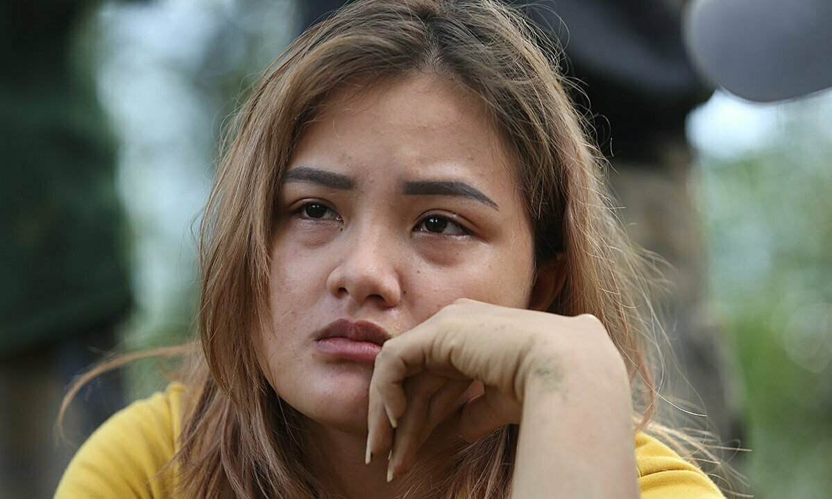 Ho Thi Hoa has her parents, sister, son and relatives buried by the landslide. Photo by VnExpress/Dac Thanh.