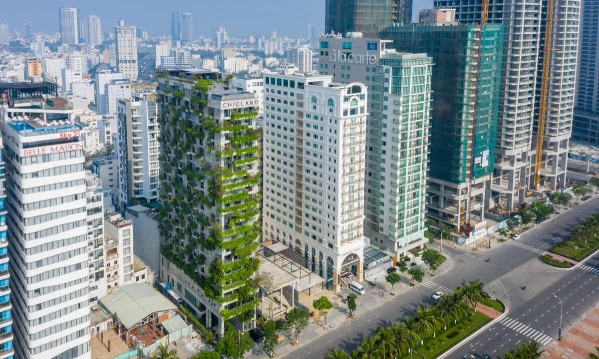 A hotel in central Da Nang City, also designed by Vo Trong Nghia, is highlighted in the section for hospitality architecture. The hotel is covered by three vertical green facades forming a small forest, making it stand out from the surrounding buildings.