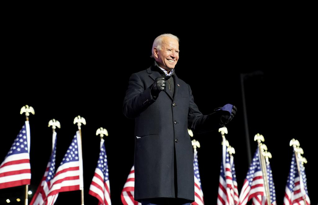 President-elect Joe Biden smiles during a drive-in campaign rally at Heinz Field in Pittsburgh, Pennsylvania, U.S., November 2, 2020. Photo by Reuters/Kevin Lamarque.