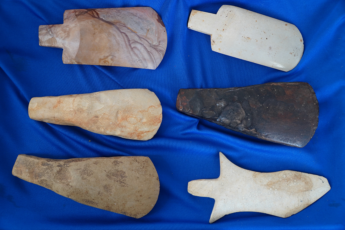 Objects made of stones and ceramics, resembling axes and picks, are collected by Van Dinh Thanh in Kon Tum Province. Photo by VnExpress/Tran Hoa.