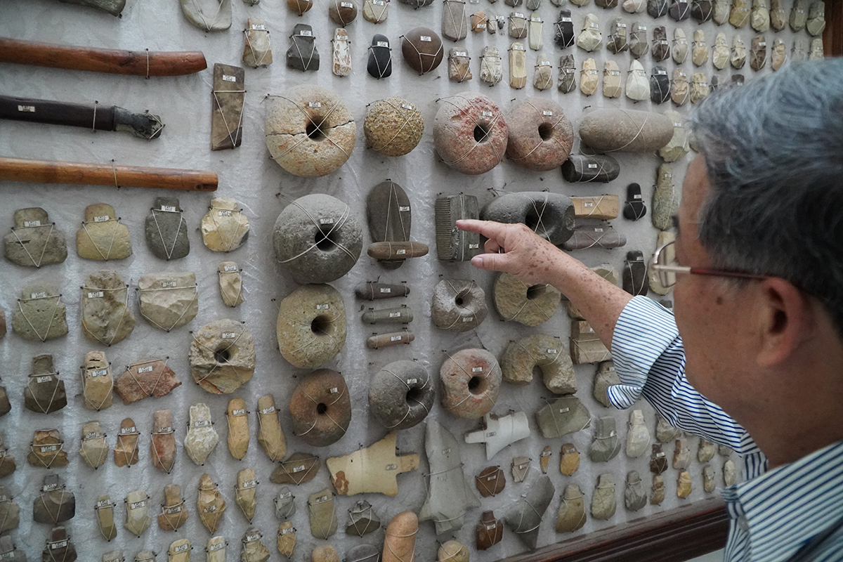 Various stone artifacts, believed to belong to prehistoric humans, are mounted on a wall in Kon Tum Province. Photo by VnExpress/Tran Hoa.
