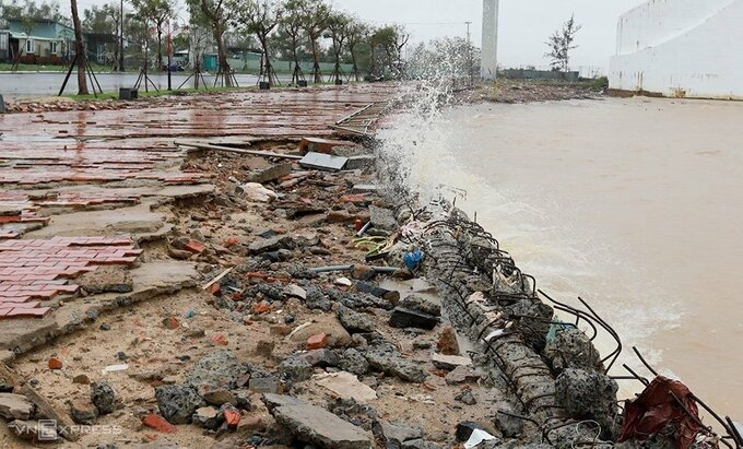 High tide wrecked portion of a sidewalk in Da Nang City.