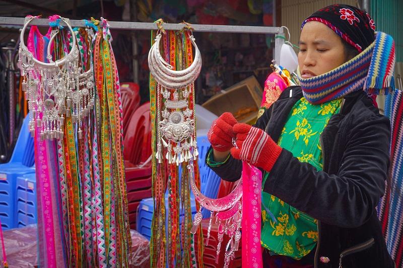 A vendor at the fair in Du Gia. Photo by Xu Kien.