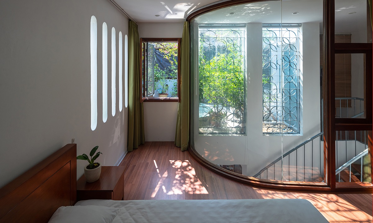 Glass windows and oval-shape holes in the wall allow natural light to penetrate.
