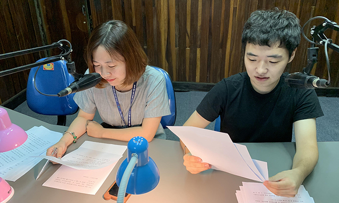 Tuan Jeon (R) and his colleague at the Voice of Vietnam. Photo courtesy of Tuan Jeon.