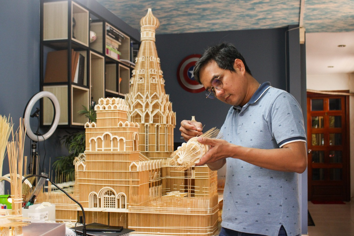 In 2016, his artworks, a miniature of the One Pillar Pagoda in Hanoi and made of 100,000 toothpicks in six months, was recognized as the biggest one Pillar Pagoda replica made of toothpicks in Vietnam. In the photo, Long is working on a miniature of the All Saint Church in Minks, Belarus, where he spent years living during his college life. The replica is made of 200,000 toothpicks in more than four months.