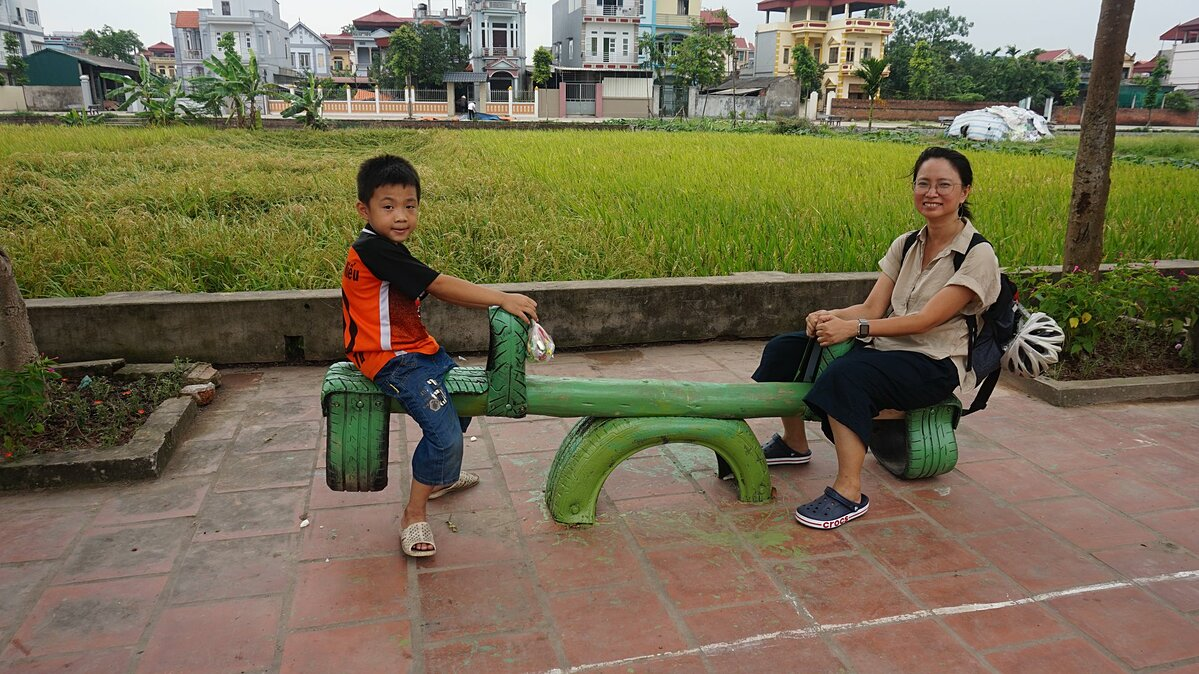 Chu Kim Duc with a boy at a Think Playgrounds project in 2019. Photo courtesy of Think Playgrounds.