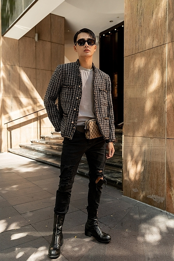 Actor Nham Phuong Nam wears a tweed jacket, a popular item among many Vietnamese male celebrities recently.