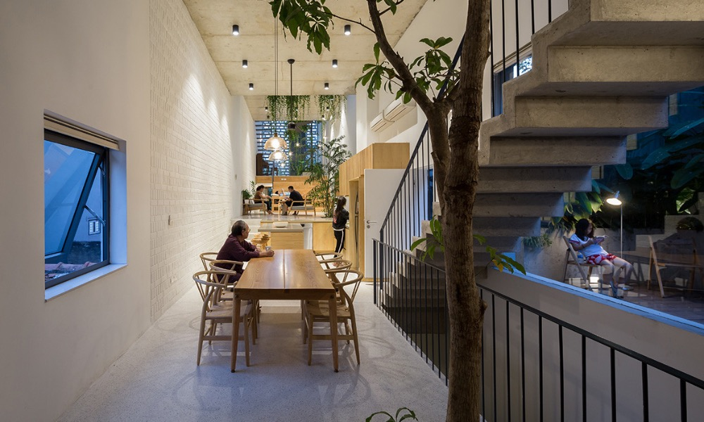 The house was built for a three-generation family, who wanted to have a refuge from the noise and air pollution and maintain the connection among family members in the age of smartphones and televisions.The common space, including the living room, library, dining, kitchen, spreads over three levels of the house, connecting people and their activities. Trees provide a cool and calm ambiance inside the house.