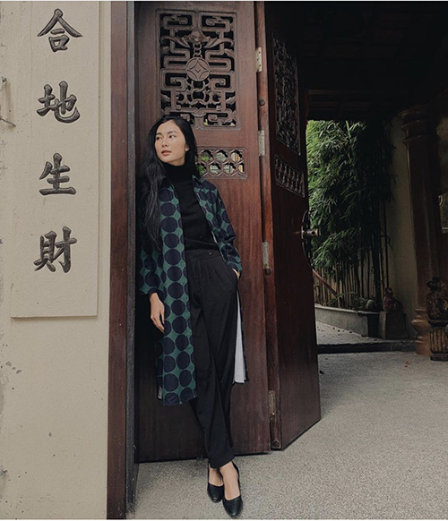 Helly Tong goes for a warm turtleneck paired with a long shirt for a comfy early winter look.