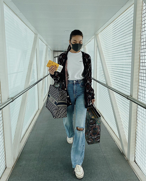 Actress and supermodel Thanh Hang dons a Gucci cardigan during a business trip in Hanoi this winter.