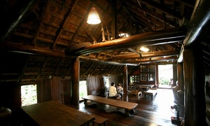 Sip on Central Highlands coffee in a traditional Ede wooden house