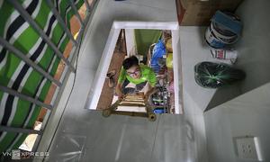 Houses shrink into rooms as Saigon street expands